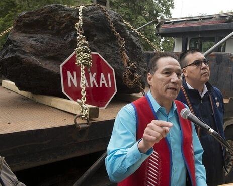 Chief Real McKenzie, left, and Chief Mike McKenzie, right of the Innu Matimekush-Lac John band speak to supporters at a protest in front of the Rio Tinto building Wednesday, October 1, 2014 in Montreal. The chiefs of the Uashat mak Mani-utenam and Matimekush-Lac John bands, along with several tribe members, were in Montreal Wednesday to deliver a pair of giant stones to the offices of Rio Tinto Alcan, saying the rocks are all they have received as payment for their land being used by the company.THE CANADIAN PRESS/Ryan Remiorz
