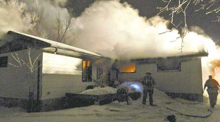 handout photo / RCMP Firefighters work to extinguish a New Year's Day blaze at the home Greg Welch and his family rented in Gimli.