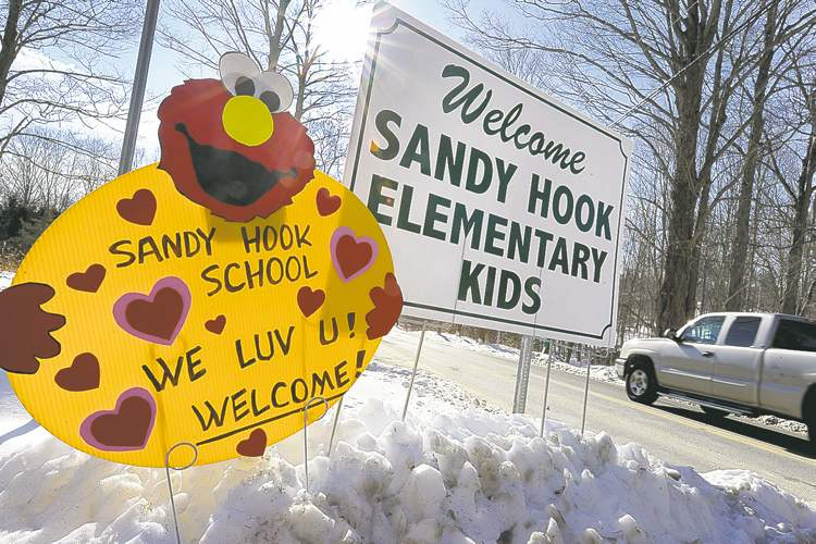 Jessica Hill / The Associated PressA sign welcomes Sandy Hook students on their first day of classes in Monroe, Conn., Thursday.