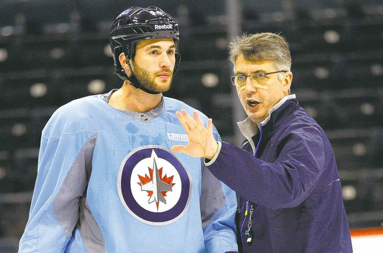 KEN GIGLIOTTI / WINNIPEG FREE PRESSJets head coach Claude Noel gives newcomer Anthony Peluso some instruction during Thursday�s practice session at the MTS Centre.