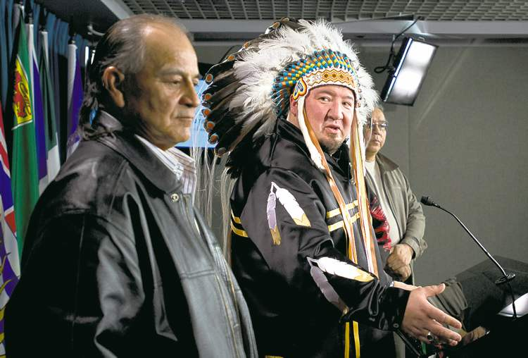 Manitoba Grand Chief Derek Nepinak (right) speaks to the media with Chief Murray Clearsky in Ottawa Friday.