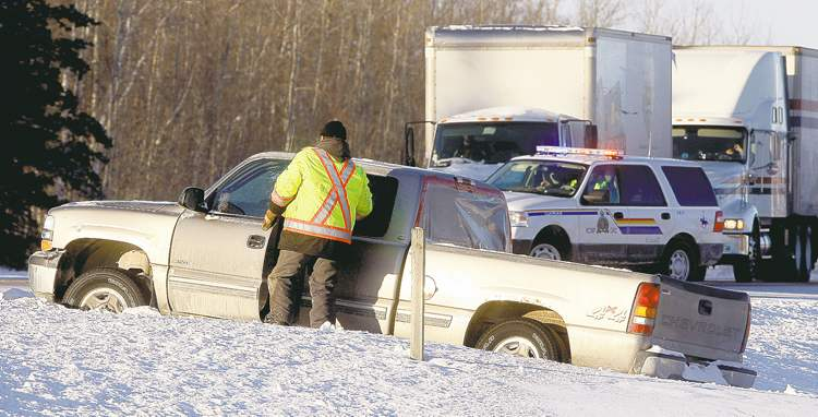 KEN GIGLIOTTI /WINNIPEG FREE PRESS Police believe the driver of this stolen pickup truck was struck and killed by a semi-trailer on the Trans-Canada Highway near Richer on Wednesday morning.