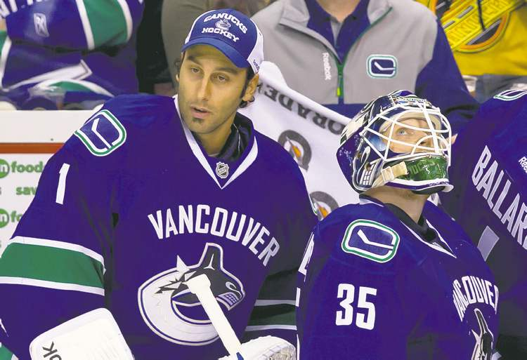 Darryl Dyck / THE CANADIAN PRESS archives Canucks backup Roberto Luongo (left) came in to relieve starter Cory Schneider before the season was 40 minutes old. Meanwhile, 1,300 kilometres to the south, San Jose�s Patrick Marleau (far right) is off to a torrid start.