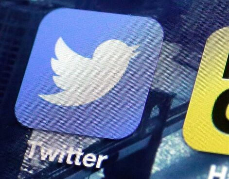 FILE - This Friday, Oct. 18, 2013, file photo shows a Twitter app on an iPhone screen, in New York. Twitter bought the company behind live video-streaming app Periscope earlier this year for a reported $100 million. (AP Photo/Richard Drew, File)