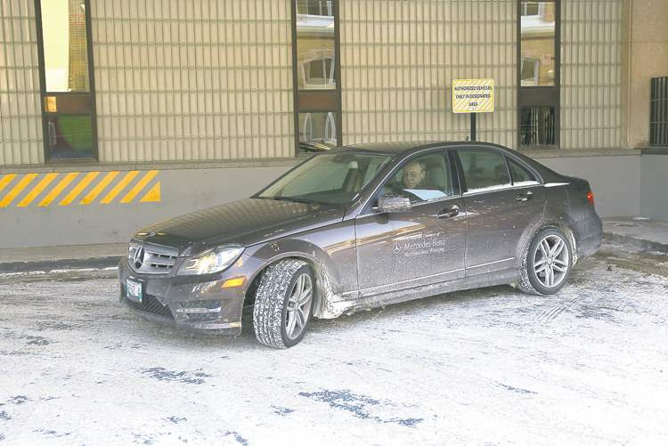 City of Winnipeg CAO Phil Sheegl parks his car in loading bay of the administration tower in the City Hall complex.