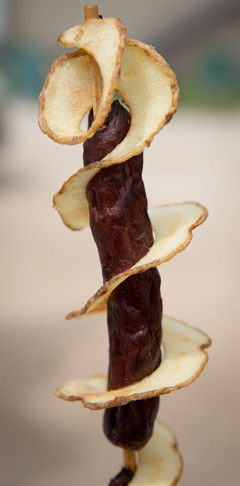 Chip dog from Chipstix stand. A fried potato wrapped around two deep fried hotdogs.
