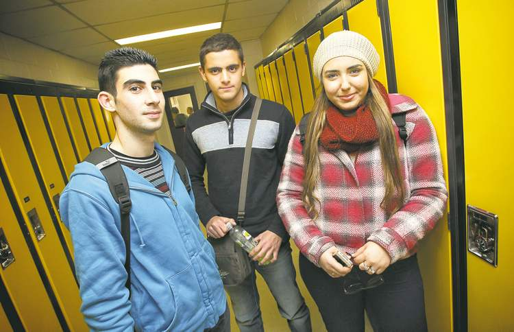 Yara Maty (centre), with Wagdi Nicola (left) and Saliba Makhoul, says he might consider returning to Canada for post-secondary education.