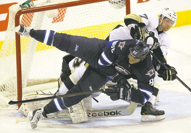 Pittsburgh's Paul Martin ensures Winnipeg's Nik Antropov is a non-factor, upending the Jet in front of the Penguins net Friday night at the MTS Centre.