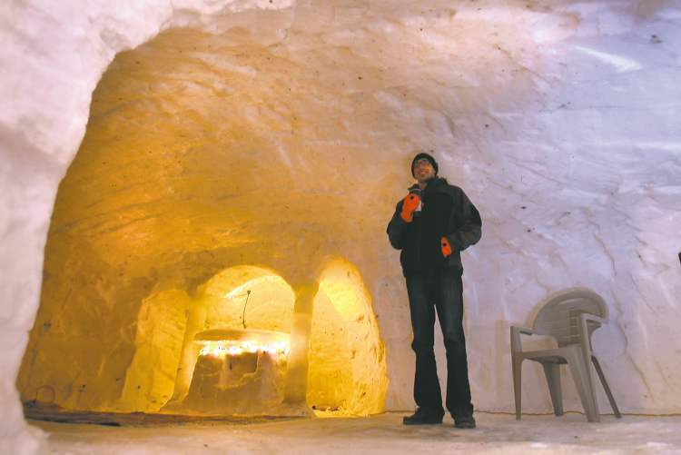 WAYNE GLOWACKI / WINNIPEG FREE PRESS  Evan Jameson, 26, and 20 of his buddies and cousins built a massive three room 'quinzloo' (quinzee/igloo) in the backyard of his parents' St. Vital home. As many as 40 people can party inside.