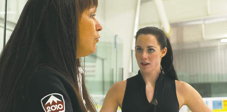 Russian-born coach Marina Zueva (left) works with Canadian ice dancer Tessa Virtue in Canton, Mich.