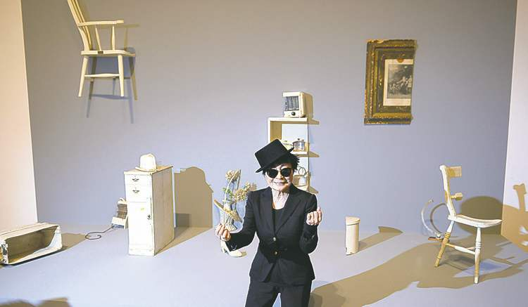Yoko Ono poses in front of her installation HALF-A-ROOM (1967) in Frankfurt last month.