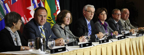 From left, Nunavut  Premier Eva Aariak, Yukon Premier Darrell Pasloski, Alberta Premier Alison Redford, Manitoba Premier Greg Selinger, B.C. Premier Christy Clark, Sask. Premier Brad Wall, NWT Premier Bob McLeod gather for the joint closing statement at the 2013 Western  Premiers Conference.