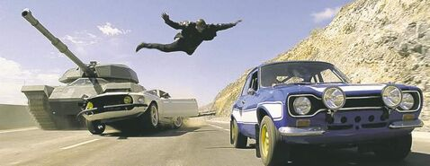 Tyrese Gibson leaps onto the roof of a car in v�Fast & Furious 6.v� Illustrates FILM-FAST-ADV24 (category e), by Jen Chaney, special to The Washington Post. Moved Wednesday, May 22, 2013. (MUST CREDIT: Universal Pictures)