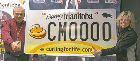 Curl Manitoba's Rob Van Kommer, left, and Kim Warburton show off specialty curling plate.
