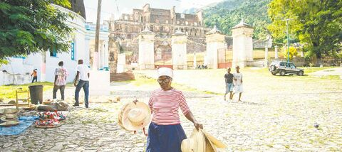 Vendors sell souvenirs near the ruins of Sans-Souci Palace, once seen as the Versailles of the Caribbean.