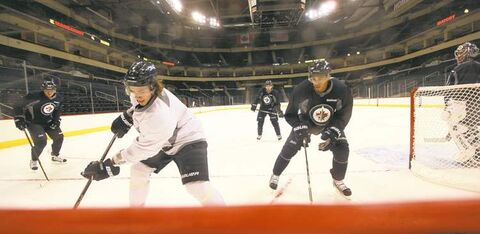 Alexander Burmistrov (left) and Evander Kane skate during yesterday's informal workout at the MTS Centre.