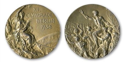 This handout provided by SCP Auctions, Inc., shows the front, left, and back, right, of one of Jesse Owens' four gold medals won at the 1936 Olympics in Berlin. SCP Auctions says the medal could go for more than $1 million when the auction opens later this month. It is