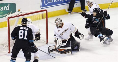 San Jose Sharks' Bracken Kearns, right, falls back after scoring a goal past Anaheim Ducks goalie Frederik Andersen during the second period of an NHL hockey game, Sunday, Dec. 29, 2013 in San Jose, Calif. (AP Photo/George Nikitin)