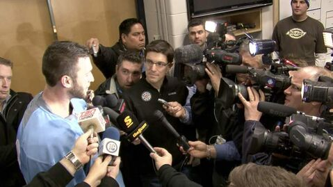 Jets' senior director of corporate communications Scott Brown (middle, back) kept close tabs when Anthony Peluso was swarmed by media after arriving in Winnipeg.