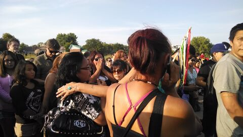 Family members of Tina Fontaine console each other at a vigil at the Alexander Docks Tuesday evening.