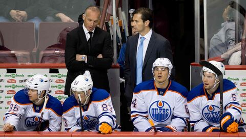 Edmonton Oilers' head coach Dallas Eakins, upper right, says, of the team's attitude despite recent losses: 'I do not want ever, ever our players to quit – no matter where we're at.'
