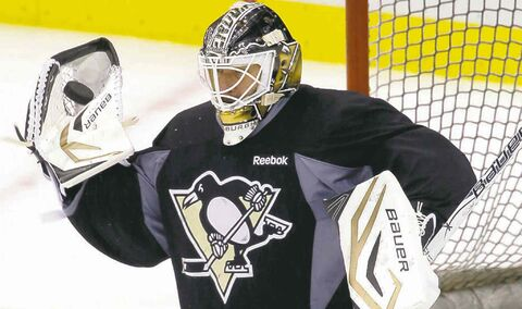Pittsburgh Penguins goalie Tomas Vokoun makes a glove save during NHL hockey practice on Friday, May 31, 2013, in Pittsburgh. The Penguins are preparing to host the Boston Bruins in Game 1 of the Eastern Conference finals of the NHL Stanley Cup playoffs on Saturday. (AP Photo/Keith Srakocic)