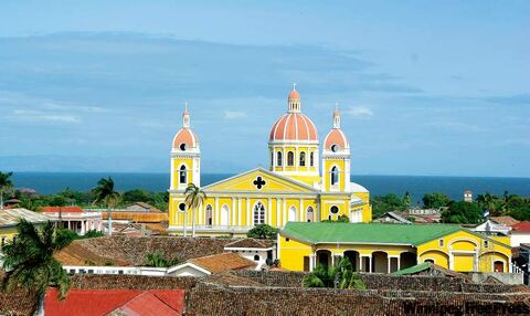 A sunlight-yellow cathedral rises above the heart of Granada, Nicaragua.