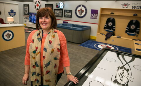 Home Expressions show manager Jan Currier shows off the Ultimate Hockey Fan Cave.