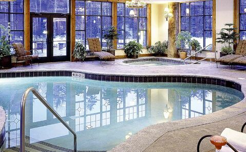 The heated indoor- outdoor pool is a highlight at Whiteface Lodge in Lake Placid, N.Y.