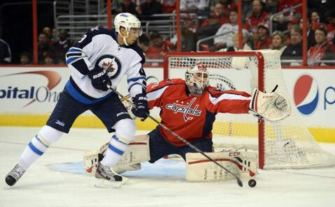 Washington Capitals goalie Braden Holtby makes a save against Winnipeg Jets left wing Evander Kane in the first period of an NHL game at the Verizon Center in Washington, D.C., Tuesday.