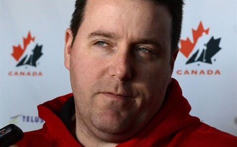 Team Canada women's hockey coach Dan Church speaks to reporters during an off day at the IIHF Women's World Hockey Championships in Ottawa on Thursday April 4, 2013. Church is stepping down from his position as Canada's women's hockey coach for personal reasons.THE CANADIAN PRESS/Sean Kilpatrick