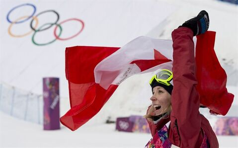 Dara Howell of Canada celebrates her gold medal win in the Ladies Ski Slopestyle at the Sochi Winter Olympics in Krasnaya Polyana, Russia, Tuesday, Feb. 11, 2014. THE CANADIAN PRESS/Jonathan Hayward