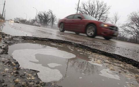 The new city budget makes road repairs a higher priority.