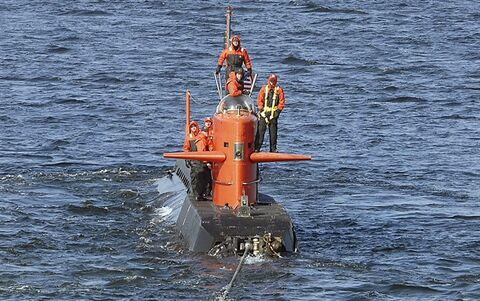 FILE - In this Feb. 2007 handout file photo provided by the US Navy, the research submarine NR-1 is towed away from U.S. Naval submarine base, in New London, Conn. The nuclear-powered NR-1, launched in Groton in 1969, was one of the most secretive vessels in the U.S. undersea force. It was taken out of service in 2008 and disassembled, its reactor disposed of. Now the Navy has collected pieces of it for an exhibit at a submarine museum in Groton, where it was based for the duration of its service life. (AP Photo/US Navy, John Fields)