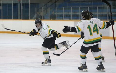 Graham Philp of the John Taylor Pipers celebrates after scoring what would be the game-winning goal against the Morden Thunder in the 2013 Milk Provincial AAAA high school hockey semi-finals at the St.James Civic Center, Saturday. the Pipers won 3-1.