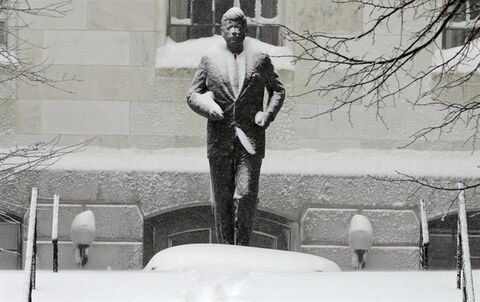 The statue of President Kennedy is covered with snow outside the Statehouse on Beacon Hill in Boston, Saturday, Feb. 9, 2013. The Boston area received about two feet of snow from a winter storm. A howling storm across the Northeast left the New York-to-Boston corridor shrouded in 1 to 3 feet of snow Saturday, stranding motorists on highways overnight and piling up drifts so high that some homeowners couldn't get their doors open. More than 650,000 homes and businesses were left without electricity. (AP Photo/Charles Krupa)