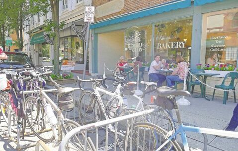 Cyclists hang out at the Runcible Spoon Bakery in Nyack, N.Y.