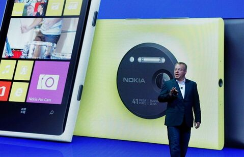 FILE - In this July 11, 2013 file photo, then Nokia CEO Stephen Elop desicribes the company's Nokia Lumia 1020, in New York. On Thursday, July 17, 2014, as part of an announcement to cut up to 18,000 jobs over the next year, Microsoft said it would discontinue its Nokia X phones and shift future product designs to its Lumia line of Windows phones. (AP Photo/Richard Drew, File)