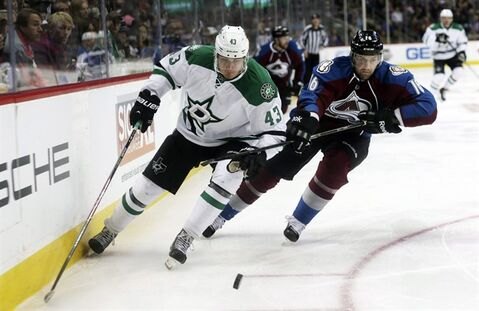 Dallas Stars winger Valeri Nichushkin, left, of Russia, pursues the puck with Colorado Avalanche defenseman Cory Sarich in the third period of an NHL hockey game in Denver on Monday, Dec. 16, 2013. Sarich is recovering in a Calgary hospital after a cycling accident this week. THE CANADIAN PRESS/ AP/David Zalubowski