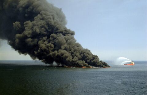 This April 22, 2010, photo shows an oil slick burning on the water after the Deepwater Horizon oil platform sank into the Gulf of Mexico. THE CANADIAN PRESS/AP