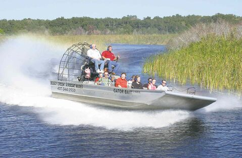 The 17-passenger airboats that Boggy Creek Airboat Rides uses can easily navigate shallow swamp or wide open water.