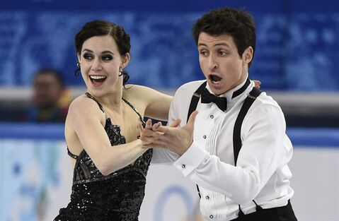 Canada's Tessa Virtue and Scott Moir perform their short dance in the ice dance competition at the Sochi Winter Olympics Sunday, February 16, 2014 in Sochi. THE CANADIAN PRESS/Paul Chiasson