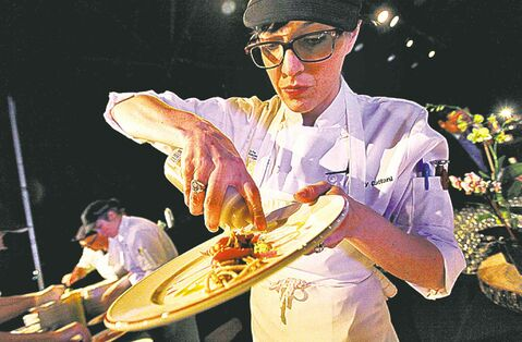 Winner Kelly Cattani of Elements puts the finishing touches on her dish.