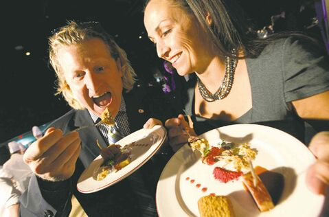 Canadian Olympians Curt Harnett and Susan Auch sample some appetizers.