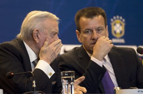 Brazil's soccer coach Dunga, right, listens to Brazilian Football Confederation Presdident Jose Maria Marin during a press conference in Rio de Janeiro, Brazil, Tuesday, Aug. 19, 2014. Dunga summoned players for upcoming friendly games against Colombia and Ecuador, the first time he picked players since taking over the national team from Luiz Felipe Scolari after the World Cup. (AP Photo/Silvia Izquierdo)