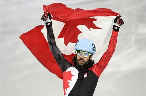 Canada's Charles Hamelin celebrates his gold medal victory in the men's 1500 metre short track speed skating final at the Sochi Winter Olympics Monday, February 10, 2014 in Sochi. THE CANADIAN PRESS/Paul Chiasson