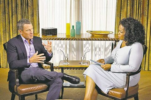 This Monday, Jan. 14, 2013 photo provided by Harpo Studios Inc., shows talk-show host Oprah Winfrey interviewing cyclist Lance Armstrong during taping for the show