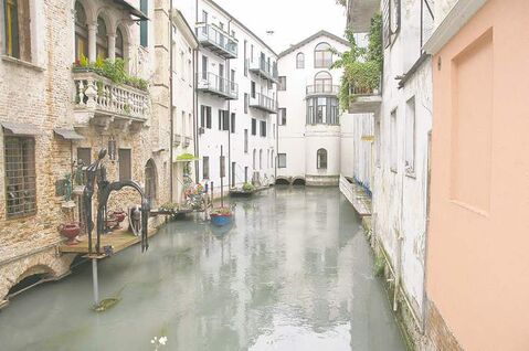 Just a 30-minute train ride from Venice, Treviso is also criss-crossed with canals.