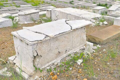 A crumbling tomb stands in the Beth Haim cemetery.