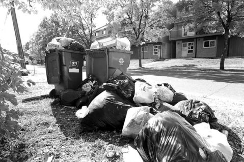 Reader says problems continue to dog new garbage pickup system.